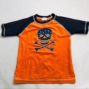 Hanna Andersson orange/navy skull rash guard 130